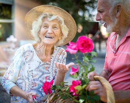 Senior couple outside tending to garden