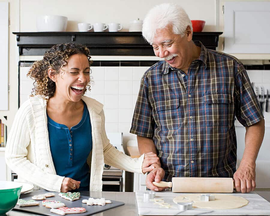 Caregiver and client baking cookies